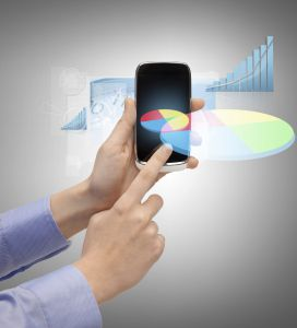technology, internet and application concept - hand holding smartphone with virtual chart